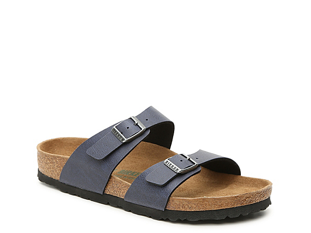 The women\\\'s Sydney sandal from Birkenstock will quickly become a simple classic in your shoe collection. This slide features two adjustable straps and a contoured cork footbed that will leave you with enough support all day long!