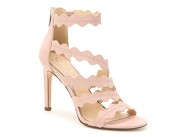 Hit the town in style when wearing the Caveena sandal from Jessica Simpson. This silhouette is fashioned with a towering heel and scalloped inspired edges that will give your ensemble extra intrigue!