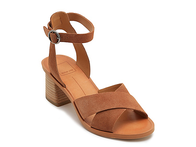 Show off your love for stylish footwear with the Rio dress sandal from Dolce Vita. With contrasting crisscross and ankle straps adding a chic touch, this sandal sports a chunky stacked block heel for added charm.