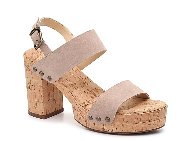 Step up your shoe collection with the Morgani sandal from Jessica Simpson. This silhouette is fashioned with stud accents and a cork platform for an extra fabulous look!