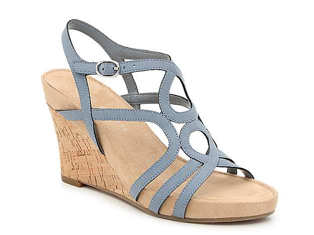 Chic summer style comes easy in the Plushin wedge sandal from Kelly & Katie. An interwoven vamp creates a strappy construction that will upgrade your maxi dresses or jean shorts.