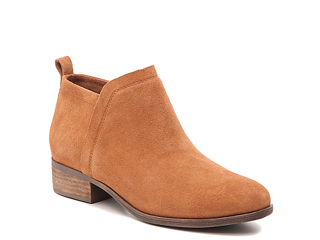 With a soft suede upper, simple styling, and trendy block heel, the Deia bootie from Toms makes the perfect addition to your wardrobe rotation. About The Brand: Toms was founded with one mission in mind: to match every pair of purchased shoes with a new pair for a child in need. With your help, 35 million pairs of shoes have found new homes with happy little feet and the One for One® model continues to expand year after year.