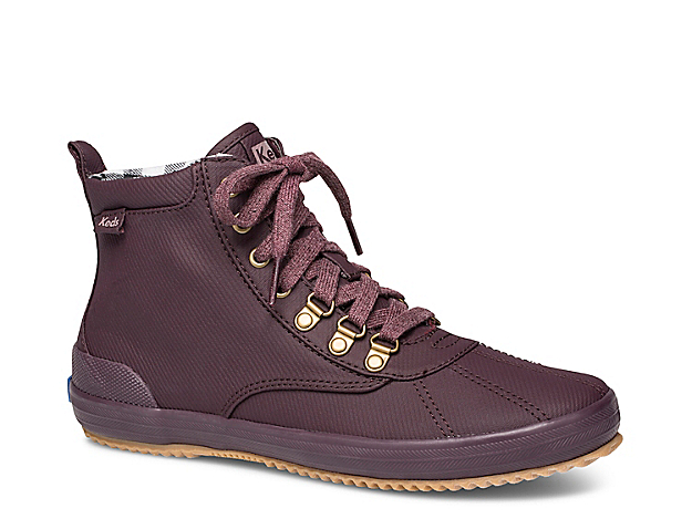 Look your best on dreary days in the Scout rain boot from Keds. These women\\\'s booties feature a sporty silhouette and water-resistant finish that\\\'s perfect for your daily commute or weekend brunch runs. Click here for Boot Measuring Guide.
