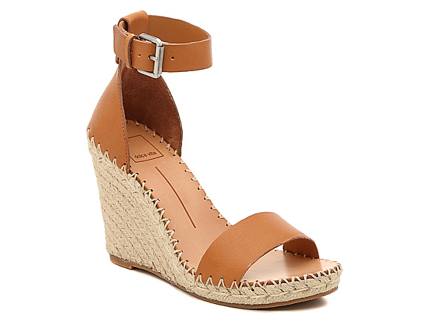 The Noor sandal from Dolce Vita will showcase your carefree and playful personality. This two-piece pair features a bold espadrille wedge heel and whipstitch detailing for visual intrigue.