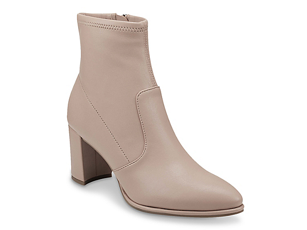 Give your ensemble all the fashion points with the Lukie bootie from Marc Fisher. This silhouette is fashioned with a secured interior zipper and stretchy material for an effortless fit. Click here for Boot Measuring Guide.