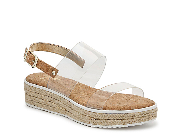 Bring out your favorite warm-weather ensemble and pair it with the Kiera wedge sandal from Mix No. 6. This silhouette is fashioned with dual lucite straps, cushioned cork footbed, and an espadrille heel for casual styling.
