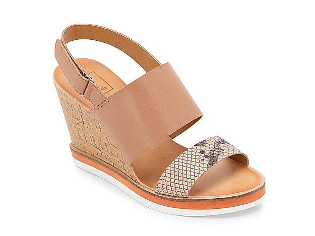 The Lizzie wedge sandal from Dolce Vita will quickly become your new go-to for any warm weather look. A snake print toe strap and sporty midsole adds extra modern style to this trendy pair.