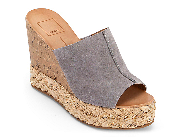 Slide into your new favorite pair with the Lewis wedge sandal from Dolce Vita. With a mixed espadrille and cork heel, this pair will make laid-back looks pop.