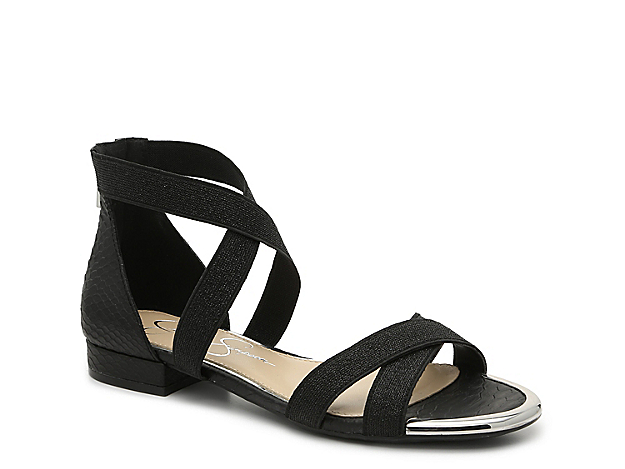 Fulfill your shoe requirements with the Aimlee sandal from Jessica Simpson. This silhouette is fashioned with elastic crisscross straps and a metallic hue that can dress up or down your ensemble!