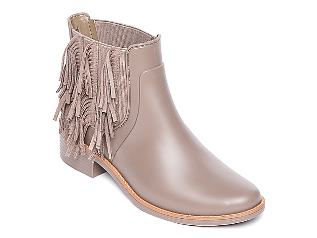 Bring trendy styling to the Penney rain boot from Bernardo. The allover rubber upper and lining with playful fringe embellishments keeps you protected from wet weather conditions while making a fashion statement! Click here for Boot Measuring Guide.