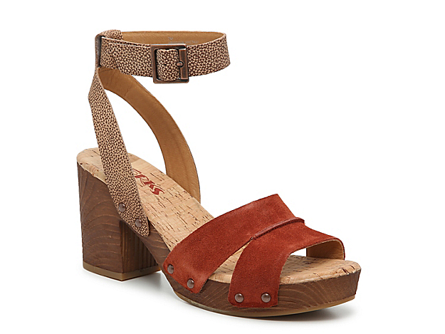 Complement your ensemble with the Mia platform sandal from Korks. This leather pair is fashioned with a cushioned cork footbed and stud accents for added edge!