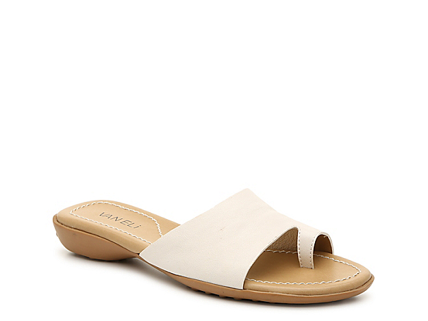 VANELi brings you the Tallis sandal for all of your warm weather looks. This slip-on pair is fashioned with a leather or suede upper, round toe ring, and slip-on styling to match with your casual style!