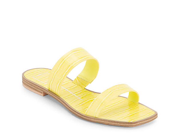 Elevate your summer look with the Isaac flat sandal from Dolce Vita. Themed with attractive croco embossing, this slide sandal features a comfortable two-strap profile and traction-friendly outsole.