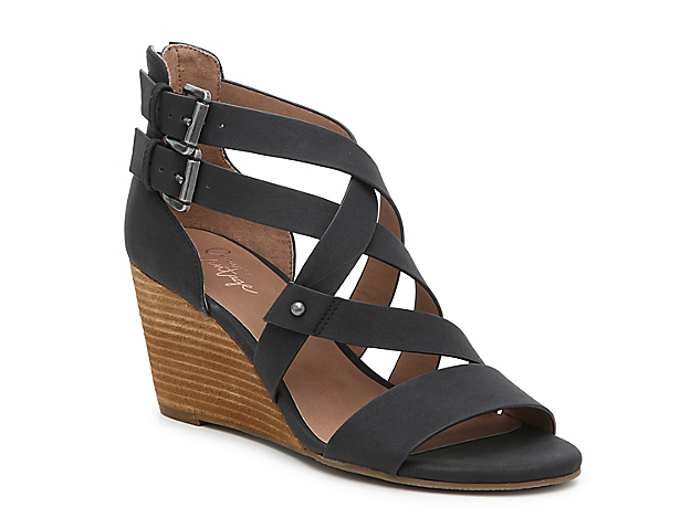 Receive instant style points with the Cirque wedge sandal from Crown Vintage. This silhouette is fashioned with decorative buckle accents and a stacked wedge that helps you step forward with ease!