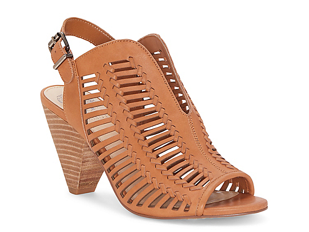 With whipstitched detailing and a trendy cone block heel, the Earinan sandal from Vince Camuto will add a boho vibe to dresses and skirts. This slingback features a dipped topline and cut-outs on the vamp for added appeal.