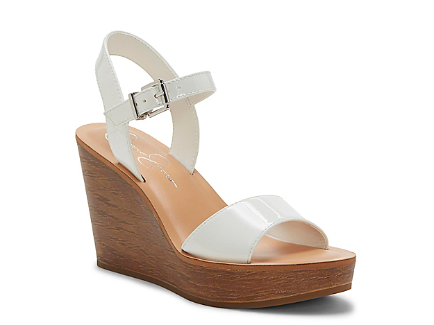 Reach new heights when wearing the Miercen wedge sandal from Jessica Simpson. This two-piece silhouette is fashioned with a retro-inspired upper and a chunky heel for trendsetting height!