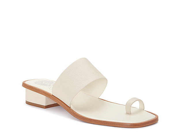 Add trendy style to any warm weather look when you slide into the Yelinda sandal from Vince Camuto. A minimalist design features a toe loop and squared off toe for modern appeal.