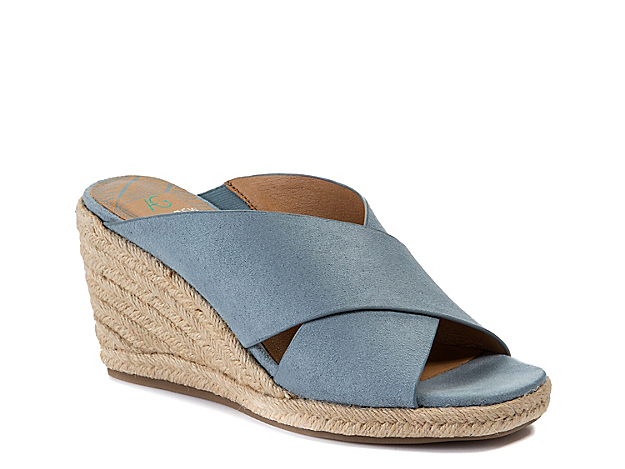 Slide into versatile summer style with the Kimber wedge sandal from Andrew Geller. With criss cross straps and an espadrille heel, this pair will complement anything from jumpsuits to jeans.