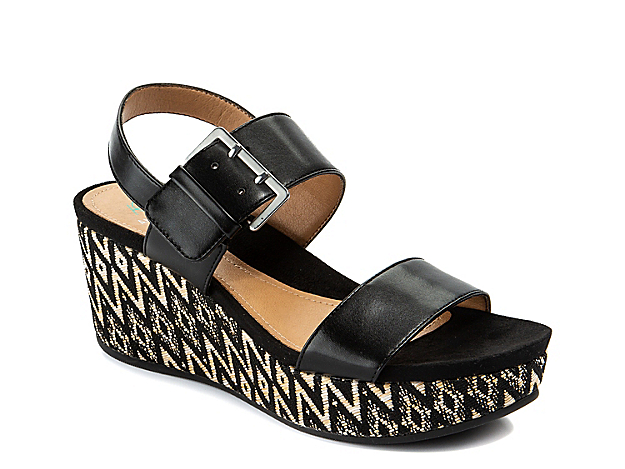 Show off laid-back island vibes with the Jasmine wedge sandal from Andrew Geller. This pair features an oversized buckle accent and boho-inspired woven wedge heel for unique appeal.