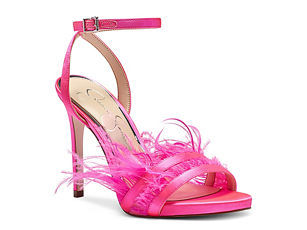 Strut with fierce appeal with the Raelin sandal from Jessica Simpson. Feather embellishments on the toe strap create eye-catching movement from every angle.