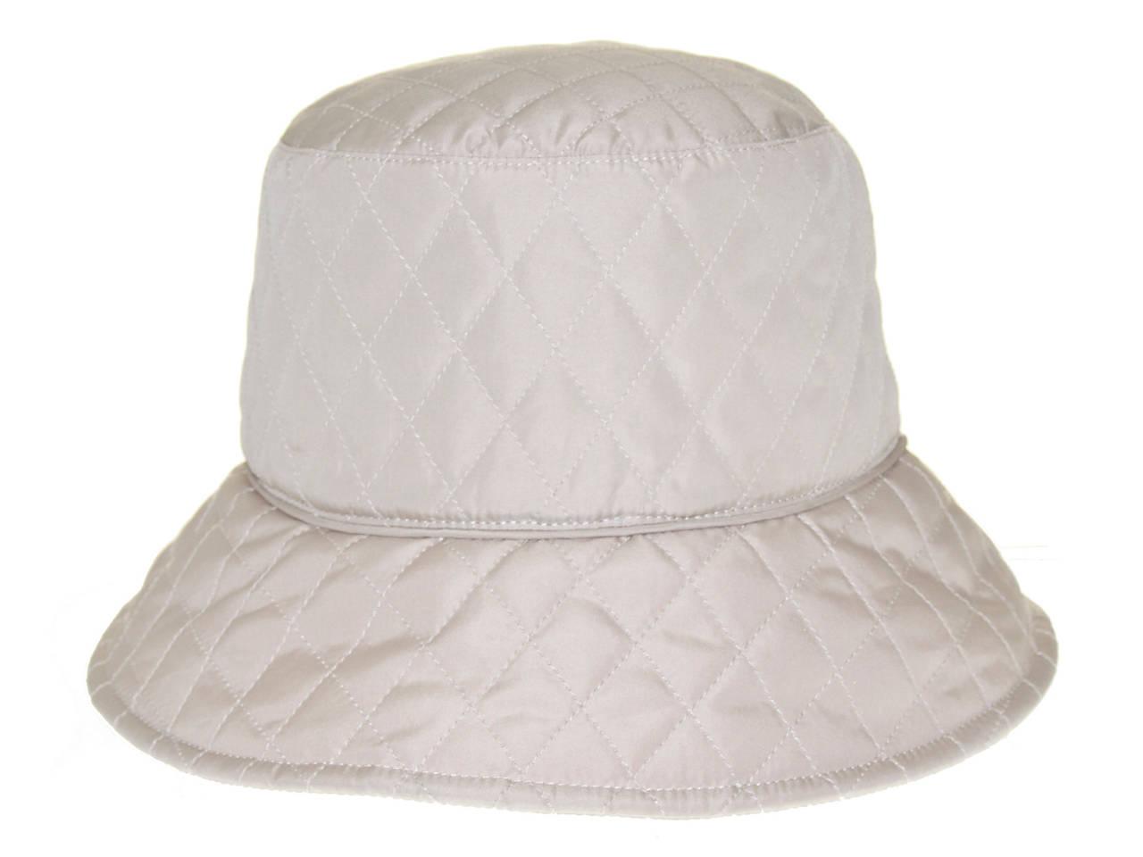 0b473557ee3 Nine West Quilted Nylon Rain Hat Women s Handbags   Accessories