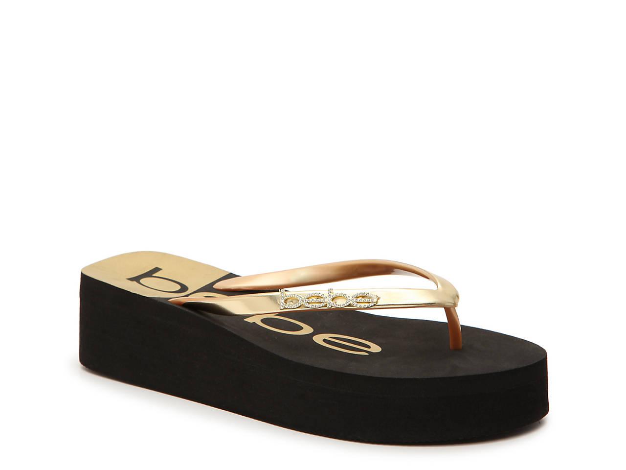 d36ff6bc75e0f bebe Jeanie Wedge Flip Flop Women s Shoes